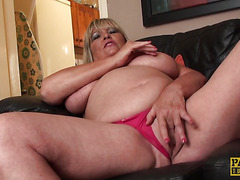 Busty submissive granny fingers her pussy