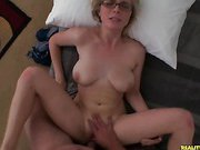 This cute blone with glasses loves taking cock.