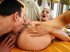 Good looking grandma having sex with a young stud