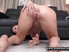 Brunette shows her huge bosom and pees