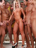 Nice blonde fucked by a horde of hungry guys