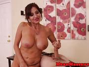Mature busty masseuse jerking restrained sub