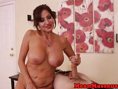 Mature busty masseuse jerking restrained sub