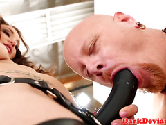 Alluring femdom mistress pegs male ass