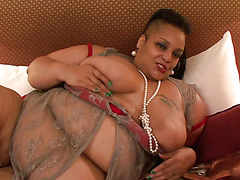 Two huge lesbians play with each others pussy on silky sheets