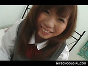 Innocent jap girl in school uniform flashes panties upskirt