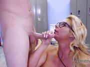 Sneak sex in locker room with busty Milf