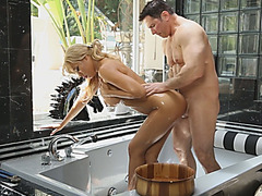 A magnificent busty blonde gives awesome erotic massage and gets wet pussy pounded