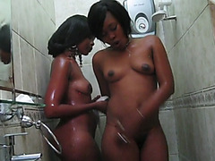 Two very hot amateur ebony chicks with great curvy bodies are showering together