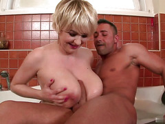 Sandra Boobies is soaking in the tub when her boyfriend barges in with