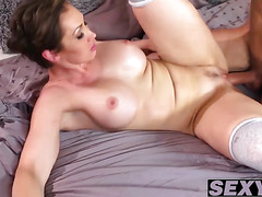 Big breasted MILF rides a rock solid pike and jumps on it