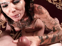 Bitchy tattooed babe taking big bites from a hard cock