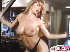 Breasty gals play with toys in classic porn