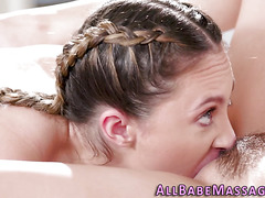 Lezbian masseuse scissoring with babe