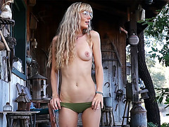 Sexy blonde MILF hot dancing and striptease outdoor
