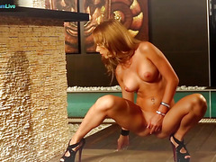Glamorous Melanie Gold fingering her shaved pussy late at night