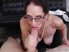 Busty cougar sucking cock like a pro