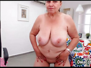 OmaFotze Mature doing striptease and masturbating her pussy