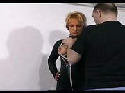 Lovely slave girl gets her tits tied up