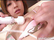 Horny Rei Sasaki in a string bikini strips and has her shaved pussy toyed