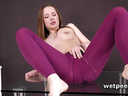 Olivia Grace gets off pissed tights and rubs cunt