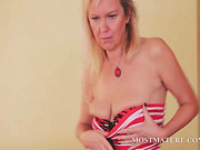 Sex bomb blonde mature sensually stripping her clothes