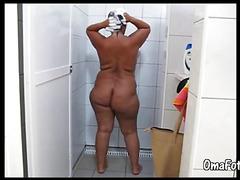 OmaFotze old mature taking a public shower