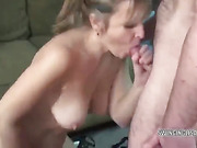 Curvy blonde housewife Liisa is down on her knees and swallowing a stiff cock